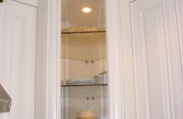 Upper corner cabinet with clear glass